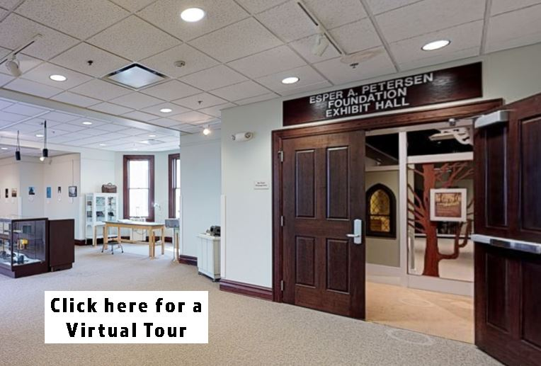 "Photo of exhibit gallery with words ""Click Here for a Virtual Tour"""